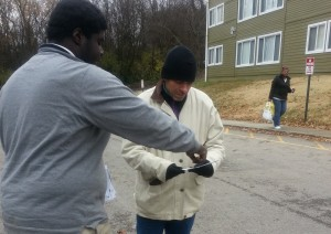 Marcus S discusses Obamacare as he hands out flyers