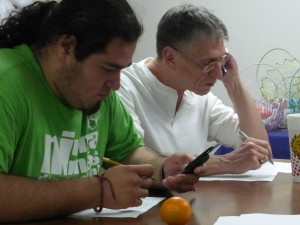 Alejandro and new volunteer Craig work the phones.